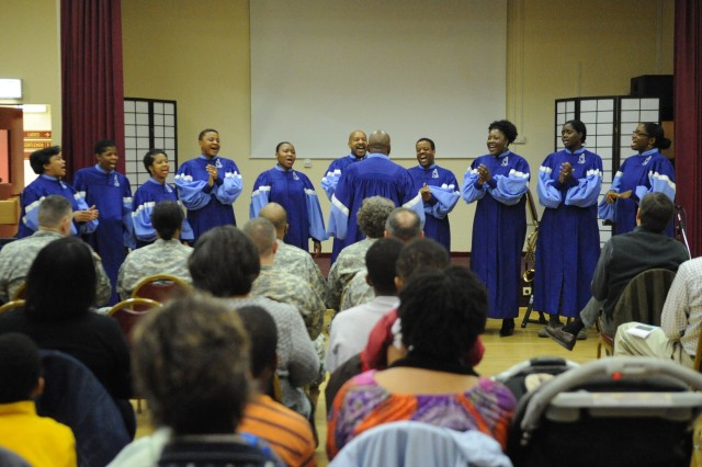The audience listens as the Vogelweh Choir sings two songs during the black history month program here Feb. 25. Also during the program, Kali Holman, an Army spouse, sang a soulful rendition of the Negro Anthem.