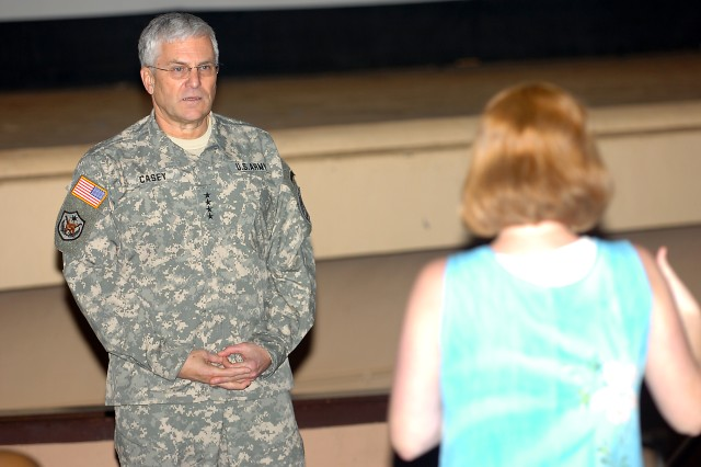 Gen. George W. Casey Jr., Army chief of staff, listens as a military spouse poses a question at the Sergeant E.R. Smith Theater at Schofield Barracks, Hawaii, Feb. 26. Casey answered questions and concerns of military families on topics ranging from education to deployment stress.