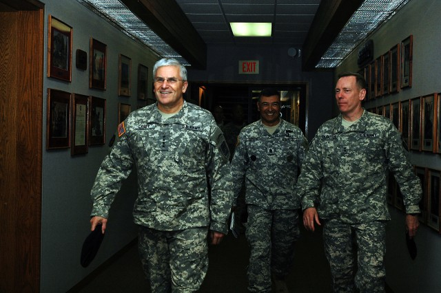 Gen. George W. Casey Jr., Army chief of staff, walks the hallways of the 25th Infantry Division headquarters with Maj. Gen. Bernard S. Champoux, commanding general, 25th Inf. Div. (right), and Command Sgt. Maj. Frank M. Leota, command sergeant major, 25th Inf. Div. at Schofield Barracks, Hawaii, Feb. 26. Casey visited the division's new commander, Champoux, and his staff before meeting with Soldiers and their family members nearby.