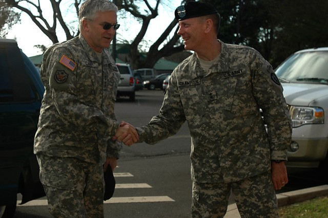 Gen. George W. Casey Jr., Army chief of staff, is greeted by Maj. Gen. Bernard S. Champoux, commanding general, 25th Infantry Division, upon arrival at the division's headquarters at Schofield Barracks, Hawaii, Feb. 26. Casey visited the division's new commander, Champoux, before meeting with Soldiers and their family members nearby.