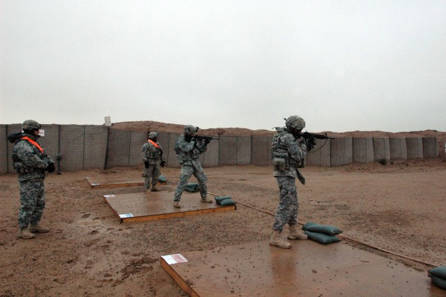 Task Force Marne Soldiers fire their weapons during United States Division-North's first biathlon, which was held at Contingency Operating Base Speicher, Iraq, Feb. 27. Forty-two competitors ran more than 7.4 miles to and from a range, putting on all their personal protective equipment to fire 10 rounds at a 25-meter target, before running back in ACUSs and boots with rifles.  (Photo by: Sgt. 1st Class Tyrone C. Marshall Jr.  25th Combat Aviation Brigade Public Affairs)