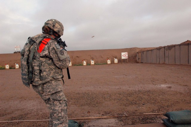 First Lieutenant Valerie Aquino, executive officer, Headquarters and Support Company, 209th Aviation Support Battalion, Task Force Wings, fires her weapon at Short Stop Range during TF Marne's first biathlon competition, held at Contingency Operating Base Speicher, near Tikrit, Iraq, Feb. 27. First Lieutenant Aquino outperformed 41 competitors during the course of the biathlon, finishing first overall, and winning the female category, with 185 points.   (Photo by: Sgt. 1st Class Tyrone C. Marshall Jr.  25th Combat Aviation Brigade Public Affairs)