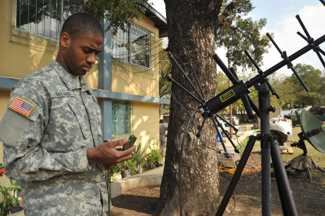 Pfc. Paul Garland, currently assigned to the Joint Forces Special Operation Component Command, checks the set up of a AV/2011 SATCOM antenna for voice and data tactical communications. The United States and other international military and civilian aid agencies are conducting humanitarian and disaster relief operations as part of Operation Unified Response in the aftermath of the earthquake that hit the area on Jan. 12, 2010.