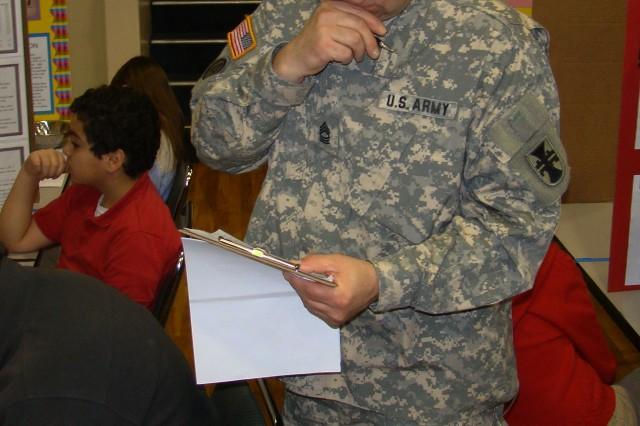Master Sgt. James McClure judges Vicksburg, Miss. School District Science fair