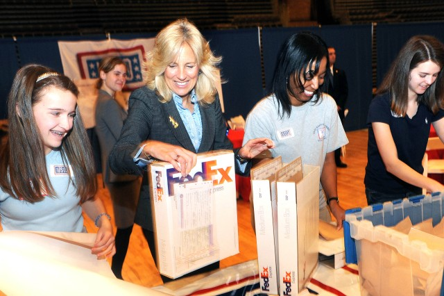 Dr. Jill Biden, wife of Vice President Joe Biden, helps students pack care packages at the District of Columbia National Guard Armory in Washington, D.C., Feb. 23, 2010, for families of deploying Florida National Guard servicemembers.