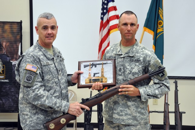 FORT BENNING, Ga.-- Col. Charles Durr, chief of staff, Maneuver Center of Excellence, stands with Sgt. 1st Class Russell Moore, 2nd Battalion, Small Arms Readiness Group, Camp Bullis, Texas, after presenting Moore with a Secretary of the Army M1 Garand Trophy Rifle for winning the 2010 All-Army Small Arms Individual Championship Feb. 27. (Photo by Michael Molinaro, USAMU PAO)