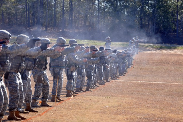 FORT BENNING, Ga.--Soldiers fire the first rounds of the 2010 All-Army Small Arms Championships downrange Feb. 21 at Parks Range during pistol match one.