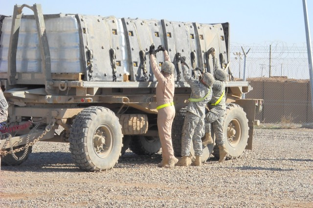 Members of the 40th Transportation Company, 395th Combat Sustainment Support Battalion, 15th Sustainment Brigade, 13th Sustainment Command (Expeditionary), practice tying down a load on a trailer during the company's safety stand-down day at Contingency Operating Location Q-West, Iraq, Feb. 6. (Courtesy photo)