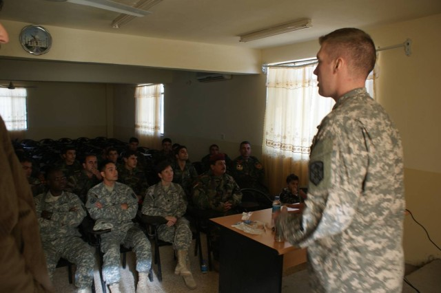 Sgt. Adam Dilts, the medical noncommissioned officer with Logistical Task Force 15, Special Troops Battalion, 15th Sustainment Brigade, 13th Sustainment Command (Expeditionary), instructs a combat life saver class at Habur Gate, Iraq. (Courtesy photo)