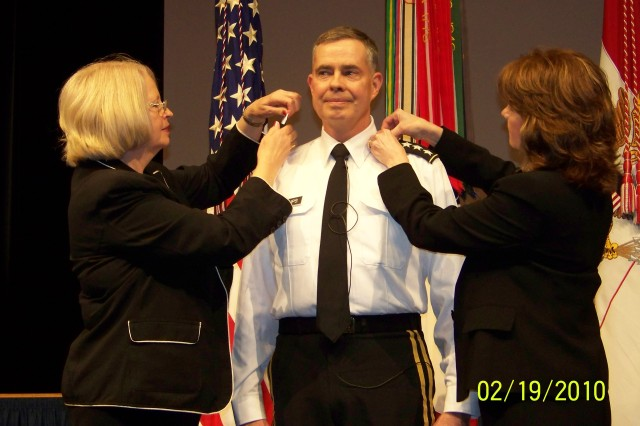 Lt. Gen. Bill Phillips receives new shoulderboards during a Feb. 19  promotion ceremony hosted by Army Chief of Staff Gen. George W. Casey Jr. Placing the new symbols of rank on his shoulders are Phillips' sisters Eloise Rains and Lorraine Wade.