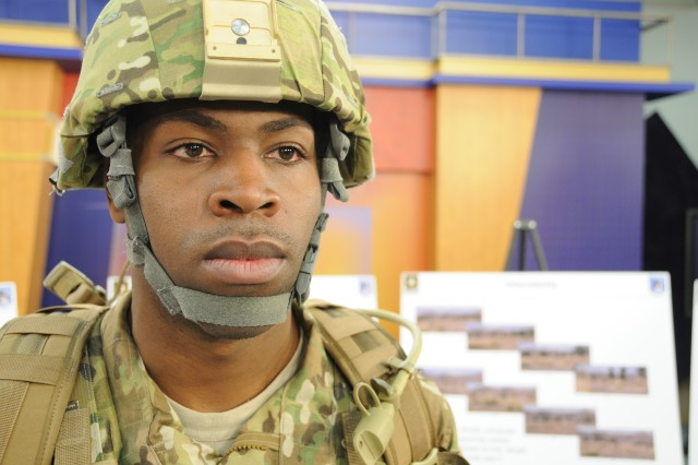 Spc. Eddie L. Williams, a computer detection repairer at Fort Belvoir, Va., models the new MultiCam Army Combat Uniform, which will be issued to Soldiers deploying to Afghanistan beginning in July.