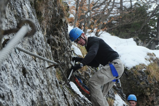 HIRSCHBACH, Germany AcE+' A steel cable guides Spc. Shawn Ridley through a klettersteig course during an outing with the Warrior adventure Quest.