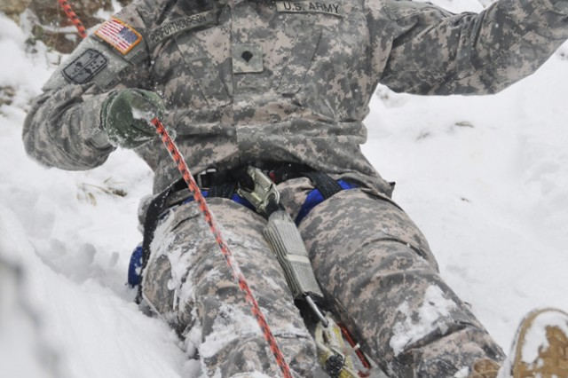 HIRSCHBACH, Germany AcE+' Spc. Justin Purifovthompson, 172nd Infantry Brigade, slides down a slippery slope during an outing with the Warrior Adventure Quest.