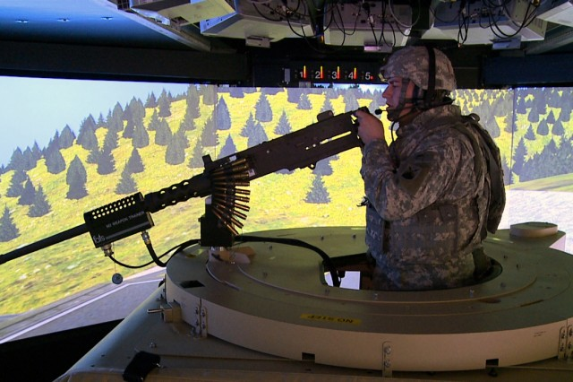 A gunner scans the terrain of the 360 degree virtual world in the Reconfigurable Vehicle Tactical Trainer, or RVTT, at the Grafenwoehr Training Area, Feb. 26.