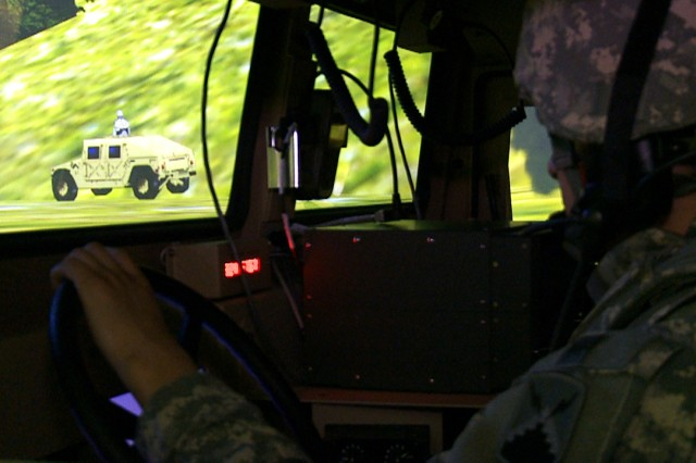 Soldiers try to maintain contact with a HMMWV avatar as part of a mission in the 7th Army's Joint Multinational Training Command's newest simulator, the Reconfigurable Vehicle Tactical Trainer, or RVTT, at the Grafenwoehr Training Area, Feb.26.
