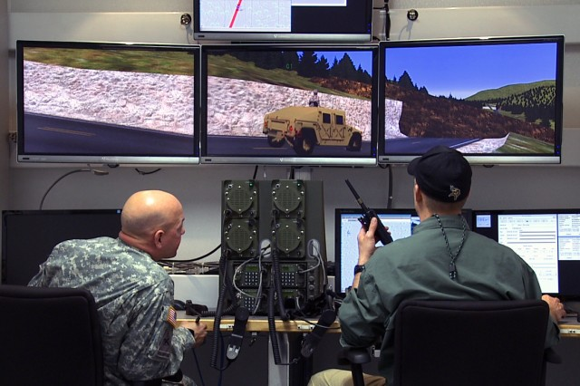 Operators from the 7th Army Joint Multinational Training Command's Training Support Center Europe control a convoy scenario in the Reconfigurable Vehicle Tactical Trainer, or RVTT, the newest virtual simulator in U.S. Army Europe, on the Grafenwoehr Training Area, Feb. 26.