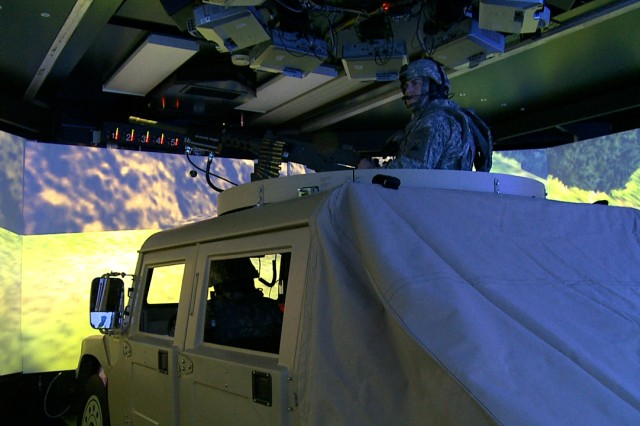 Soldiers go through a counter-IED mission in the Reconfigurable Vehicle Tactical Trainer, or RVTT, at the Grafenwoehr Training Area, Feb.26. The 360-degree simulator is the 7th Army Joint Multinational Training Command's newest virtual training