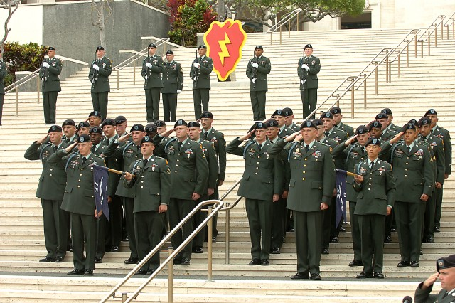 "Soldiers of Companies C and D, 2nd Battalion, 27th Infantry Regiment, 25th Infantry Division, stand in formation during the interment ceremony in honor of retired Army Gen. Frederick C. Weyand at Honolulu's National Memorial Cemetery of the Pacific, Feb. 27. Weyand, who served as the 27th Chief of Staff of the U.S. Army and a former commanding general of both the 25th Inf. Div. and U.S. Army Pacific, routinely directed the efforts of the 2/27 ""Wolfhounds"" during his command leadership throughout the Vietnam War. Because of the trust Weyand placed in the performance and valor of the Wolfhounds, the battalion was requested to serve a role in the ceremony to honor the memory of Weyand. (U.S. Army photo by Spc. Jesus J. Aranda, 25th Infantry Division Public Affairs Office)"
