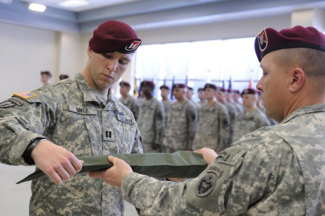 FORT RICHARDSON, Alaska - Army Capt. Ryan Hintz and 1st Sgt. Troy Whitcome case the 23rd Engineer Company (Airborne), 6th Engineer Battalion guidon during the company's Feb. 19 deployment ceremony at Lee Reserve Center. The guidon will be uncased upon arriving in Afghanistan.