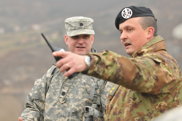 Lt. Col. David Brady, 1-144th MTF commander, Modesto, Calif., works with his Italian counterpart during the Relief-in-Place process that preceded the start of 1-144th MTF's security mission in northern Kosovo.
