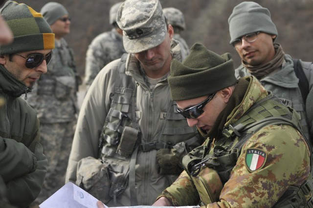 Soldiers from the 1-144th MTF, based at Camp Bondsteel, Kosovo, work with Soldiers from Italy to learn about Camp Nothing Hill prior to beginning their security mission in northern Kosovo.