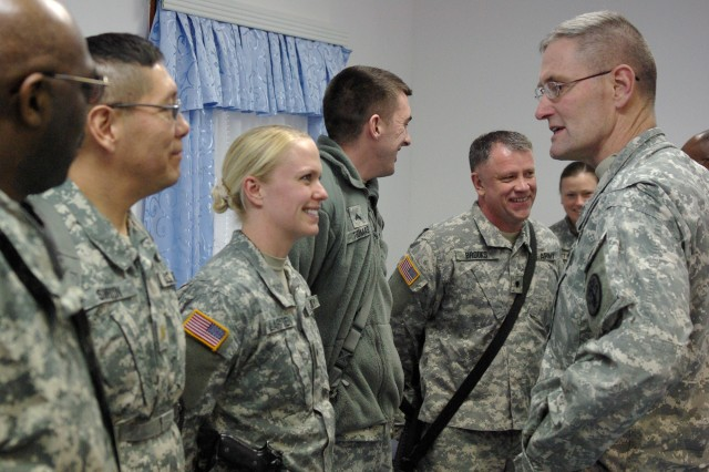 Brig. Gen. Keith Gallagher, commanding general of the Europe Regional Medical Command, talks with a group of Task Force Med Falcon Soldiers, including Spc. Lindsey Lauritsen, West Fargo, N.D., Cpl. Bobby Thomas, Louisville, Ky., and Spc. Jack Brooks, Whitley City, Ky., during a visit to Camp Bondsteel March 2.