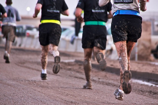 Due to heavy rain, runners had to navigate slippery and muddy roads during the Fallen Soldier Half-Marathon Feb. 28. The run was organized by 4th Battalion, 227th Aviation Regiment, 1st Air Cavalry Brigade, 1st Cavalry Division, to honor Soldiers who gave their lives as part of Operation Iraqi Freedom.