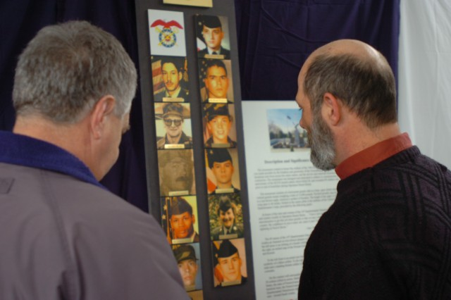 GREENSBURG, Pa. - Friends and families gather for a memorial ceremony at the local U.S. Army Reserve Center recently.  Posted on a board inside the facility are photos of the 13 Army Reserve Soldiers from the 14th Quartermaster Company who lost their lives on Feb. 25, 1991 while deployed in support of Operation Desert Storm.