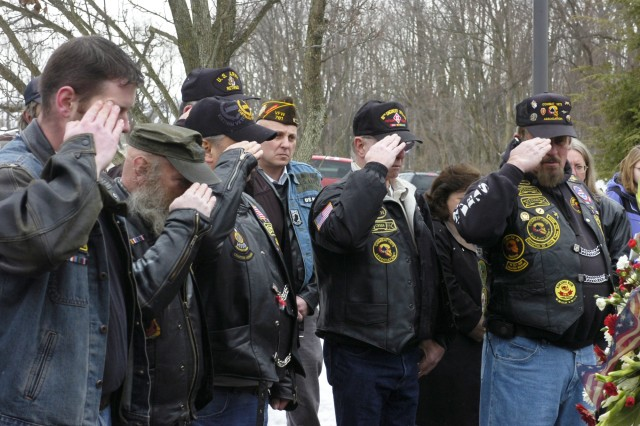 """GREENSBURG, Pa. - Members of the Combat Veterans Association salute the memorial site of Army Reserve Soldiers with the 14th Quartermaster Company during a ceremony at the U.S. Army Reserve Center here Thursday.  The event marked the 19th anniversary of an Iraqi Scud missile attack in Saudi Arabia that took the lives of 13 of the unit's Soldiers during Operation Desert Storm. """""""