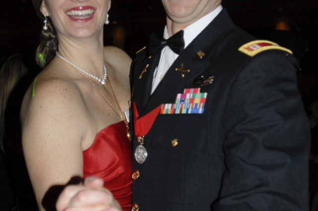 Capt. Joseph Himpelmann,and his wife Stacy, both from Chicago, enjoy a dance during the 2nd Battalion, 82nd Field Artillery Regiment's ball Feb. 20 at the Killeen Civic Center. Himpelmann is the commander of Battery B.