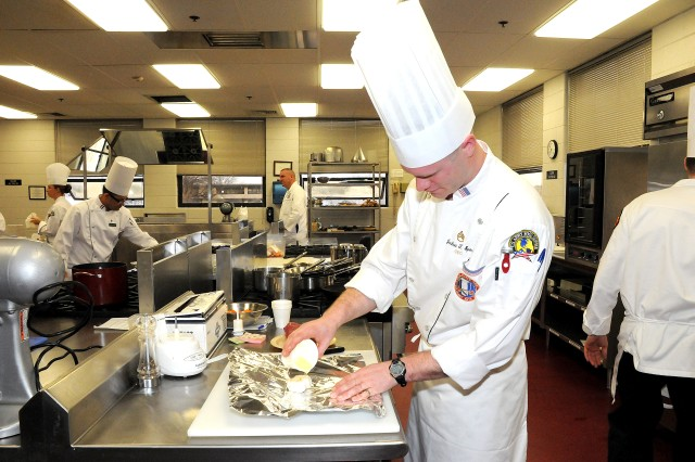 Fort Monroe's Staff Sgt. Joshua Spiess prepares a head of garlic while competing for the Armed Forces Chef of the Year Feb. 28. Spiess was the only competitor who earned a gold medal in the event, which is judged on a point system. The Armed Forces Chef of the Year competition was the first cooking event in the 35th U.S. Army Culinary Arts Competition.