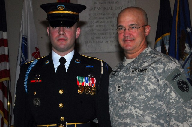 Staff Sgt. John Wolfe stands tall with Maj. Gen. Karl Horst, commanding general JFHQ-NCR and the U.S. Army Military District of Washington, after earning Tomb Identification Badge #579 at the Tomb of the Unknown Soldier, Arlington National Cemetery, Va.