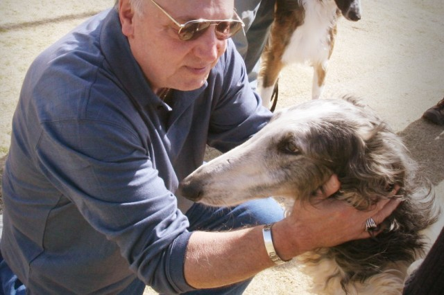 Lucien Mason, Vietnam War veteran, introduces himself to Corona, a Borzoi Russian Wolfhound. The pair met for the first time Feb. 20. Corona will receive at least 50 hours of training and evaluation before she will be placed with Mason. Following that, both veteran and dog will receive weekly hour-long sessions to train for Mason's specific needs.