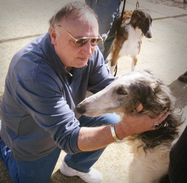 Lucien Mason, Vietnam War veteran, introduces himself to Corona, a Borzoi Russian Wolfhound. The pair met for the first time Feb. 20. Corona will receive at least 50 hours of training and evaluation before she will be placed with Mason. Following tha...