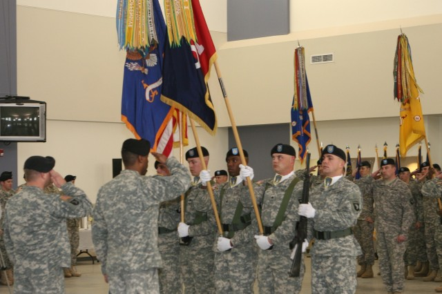FORT CAMPBELL, Ky. - the brigade salutes their colors before encasing them in advance of their upcoming deployment to Afghanistan this March. The ceremony marked the transfer of the command and control of 101st CAB garrison operations to Company E, 101st CAB, rear detachment.