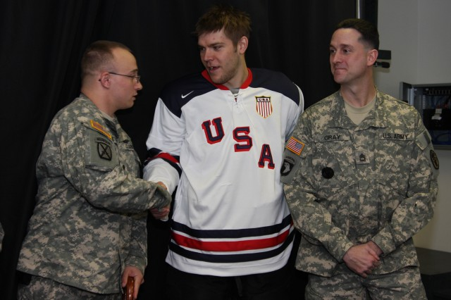 IMG_5264: Paul Stastny (center), Colorado Avalanche forward thanks Spc. Aaron Ritter (left), WTB Soldier and Sgt. 1st Class Daniel Gray, WTB platoon sergeant for their sacrifices. The Soldiers met Stastny and Predators defenseman Ryan Suter Feb. 4 in Nashville to offer encouragement before the lighting of the 2010 Winter Olympic torch.