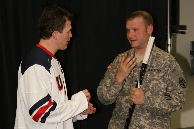 "IMG_5150: ""My youngest son's first game was watching the Predators smash Tampa Bay in December,"" Sgt. John Wawruck, squad leader for Fort Campbell's Warrior Transition Battalion tells Ryan Suter, defenseman for the Predators. Wawruck 'adopted' Suter as part of an Operation Homefront initiative to pair Team USA Olympic hockey players with service members to help encourage the players in the 2010 Winter Olympics."