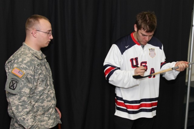 """IMG_5219: """"I grew up in Colorado and watched the Avs take home the Stanley Cup their first year in the NHL,"""" Spc. Aaron Ritter, WTB Soldier shares with Colorado Avalanche forward Paul Stastny. The Soldier and Olympic player found they had a lot in common, being the same age and having the same favorite Colorado hockey player growing up, Joe Sakic. Operation Homefront linked the two through an initiative to pair United States service members with Team USA Olympic hockey players."""