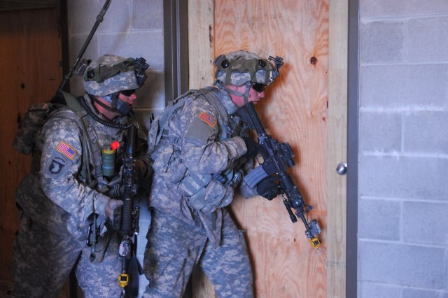 Specialist Eric Downey and Private Hunter Mercher, both assigned to Co. A, 3/7 Inf. Regt., clear a building as part of a cordon and search operation during 4th IBCT's pre-deployment training exercise, Vanguard Focus, at Fort Stewart, March 1.
