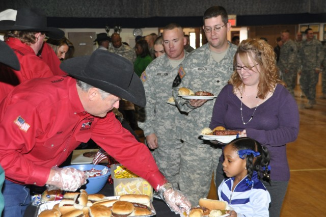FORT CARSON, Colo.-Keith Overland, a volunteer with the All-American Beef Battalion, serves Family members of the 4th Engineer Battalion.