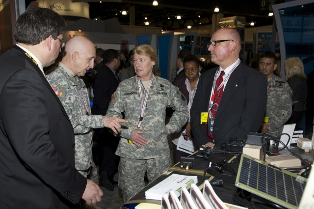 Gen. Ann E. Dunwoody, Army Materiel Command commanding general (center) speaks with Maj. Gen. Nick Justice Research, Development and Engineering Command commanding general Feb. 24 at the Association of the U.S. Army Winter Convention in Fort Lauderdale, Fla.