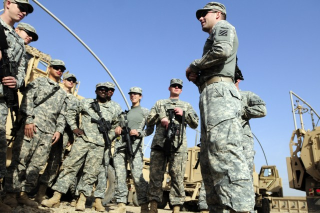 BAGHDAD - First Lieutenant Michael McCrory, 3rd Brigade Support Battalion A Co., briefs his quick response force team outside their MRAPs on Contingency Operating Station Falcon March 7. As part of a quick response force team, they were prepared to aid the Iraqi Security Forces if asked to during the elections. They were never requested.
