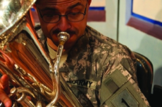Staff Sgt. Sgt. James Barrientes, a euphonium player with the Cantigny Brass Quintet and a Van Nuys, Calif. resident, plays during the Wasit Arts Cultural Festival, Feb. 27, 2010. The quintet, part of the 1st Infantry Division band, performed at the festival as part of the celebration of children in the community.