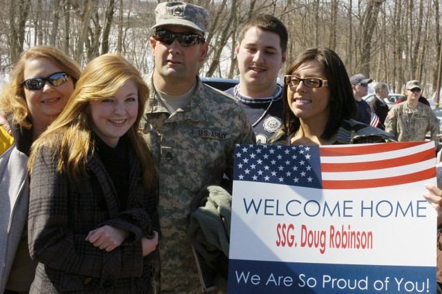 GREENSBURG, Pa. - Staff Sgt. Doug Robinson stands with his family after returning from a year-long deployment with the 14th Quartermaster Company in Iraq at the U.S. Army Reserve Center here Sunday. (US Army Photo by Spc. Michael T. Crawford, 316th ESC Public Affairs Office)