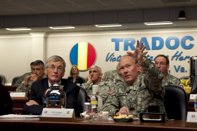 Gen. Martin E. Dempsey, commanding general of U.S. Army Training and Doctrine Command, introduces the Honorable John McHugh, Secretary of the Army, to TRADOC functions and responsibilities during a briefing March 5. This was McHugh's first visit to TRADOC headquarters at Fort Monroe, Va.