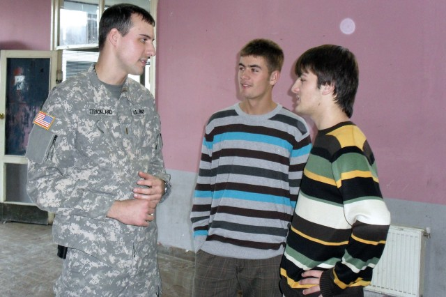 2nd Lt. Jonathan E. Strickland, of the 2-151st Aviation Battalion of South Carolina, talks with high school students from an English as a Second Language Class at the Ferizaj, Kosovo, Youth Center.
