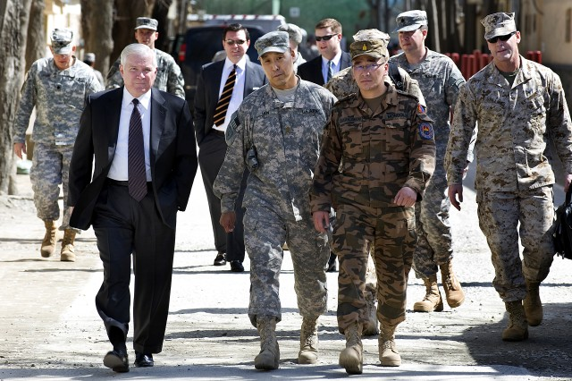 U.S. Defense Secretary Robert M. Gates, left, walks with Maj. Wayne Don, advisor for the Mongolian Expeditionary Task Force assigned to NATO Training Mission Afghanistan, and Mongolian Lt. Col. Javkhlanbayar, senior representative of the contingent, on Camp Eggers in Kabul, March 8, 2010.