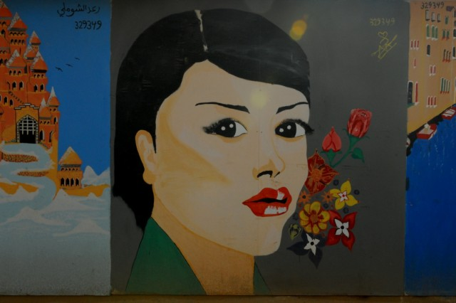 A mural painted by a detainee at the Theatre Interment Facility at Camp Bucca, Iraq, near the southern city of Umm Qasr. Numerous murals exhibited figurative themes about good versus evil, while others had more literal subjects like serene water landscapes or women and children.