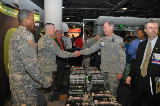 Sgt. Darwynn McPherson, SDDC Soldier of the Year, and Sgt. Billy Richardson, SDDC NCO of the Year, greet Maj. Gen. James L. Hodge as the exhibit hall opens for the 2010 SDDC Training Symposium and NDTA Expo.