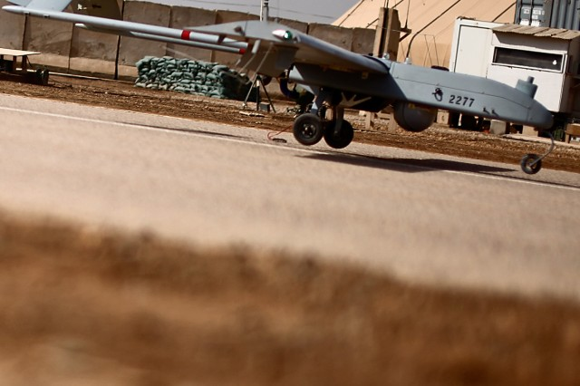 CAMP TAJI, Iraq - A Shadow unmanned aerial vehicle is about to touch down, marking a momentous occasion for the operators and maintainers of 10th Mountain Division, 3rd Infantry Division and 2nd Infantry Division, all of whom fall under Company G, 2nd Battalion, 227th Aviation Regiment, 1st Air Cavalry Brigade, 1st Cavalry Division, U.S. Division-Center, as this aircraft pushed the UAV hub to the 20,000 flight hour mark March 7. The Shadow launch site, operated by Co. G, is the launch, landing and maintenance hub for all UAVs being used by used by the three brigades and has reached the 20,000 flight hour mark in 10 months of operation.
